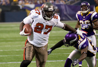 MINNEAPOLIS, MN - SEPTEMBER 18: LeGarrette Blount #27 of the Tampa Bay Buccaneers avoids a tackle by Husain Abdullah #39 of the Minnesota Vikings in the third quarter on September 18, 2011 at Hubert H. Humphrey Metrodome in Minneapolis, Minnesota. Blount