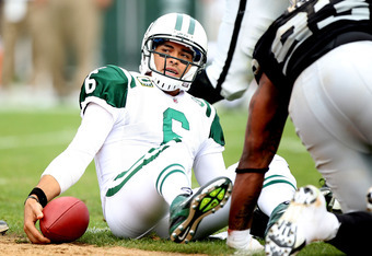 OAKLAND, CA - SEPTEMBER 25:  Mark Sanchez #6 of the New York Jets looks after being sacked against the Oakland Raiders at O.co Coliseum on September 25, 2011 in Oakland, California.  (Photo by Jed Jacobsohn/Getty Images)