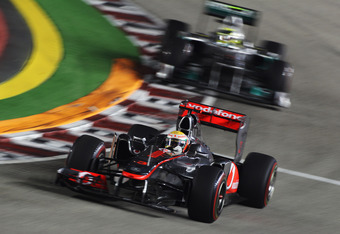 SINGAPORE - SEPTEMBER 25:  Lewis Hamilton of Great Britain and McLaren drives during the Singapore Formula One Grand Prix at the Marina Bay Street Circuit on September 25, 2011 in Singapore.  (Photo by Mark Thompson/Getty Images)