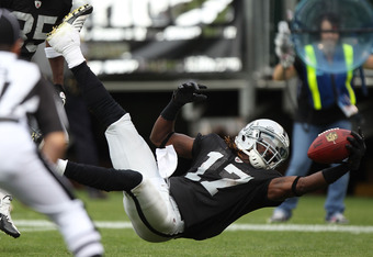 OAKLAND, CA - SEPTEMBER 25: Denarius Moore #17 of the Oakland Raiders runs for a touchdown against the New York Jets at O.co Coliseum on September 25, 2011 in Oakland, California.  (Photo by Jed Jacobsohn/Getty Images)