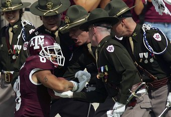 COLLEGE STATION, TX - OCTOBER 14:  Wide receiver Kerry Franks #8 of the Texas A&M Aggies is helped up by Corp Cadets after making a 40-yard pass reception against the Missouri Tigers at Kyle Field on October 14, 2006 in College Station, Texas.  (Photo by