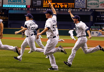 ST PETERSBURG, FL - SEPTEMBER 28:  The Tampa Bay Rays celebrate their victory over the New York Yankees at Tropicana Field on September 28, 2011 in St. Petersburg, Florida.  (Photo by J. Meric/Getty Images)