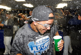 ST PETERSBURG, FL - SEPTEMBER 28:  Pitcher Juan Cruz #37 of the Tampa Bay Rays celebrates the Rays victory over the New York Yankees at Tropicana Field on September 28, 2011 in St. Petersburg, Florida.  (Photo by J. Meric/Getty Images)