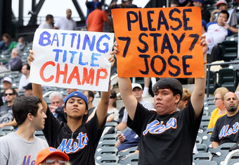 NEW YORK, NY - SEPTEMBER 28:  Fans hold banners in reference to Jose Reyes #7 of the New York Mets during the game against the Cincinnati Reds at Citi Field on September 28, 2011 in the Flushing neighborhood of the Queens borough of New York City.  (Photo