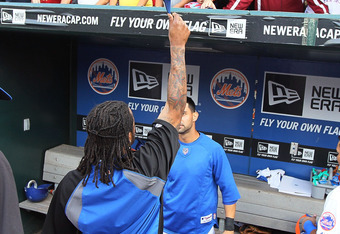 NEW YORK, NY - SEPTEMBER 28:  Jose Reyes #7 salutes the fans after the game against the Cincinnati Reds at Citi Field on September 28, 2011 in the Flushing neighborhood of the Queens borough of New York City. Reyes is an unrestricted free agent at the end
