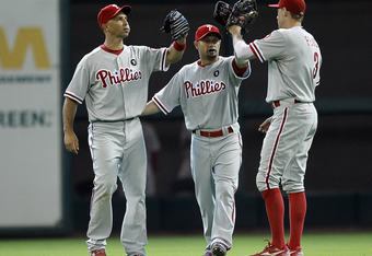 HOUSTON - SEPTEMBER 14:  Raul Ibanez #29, Shane Victorino #8 and Hunter Pence #3 of the Philadelphia Phillies celebrate a 1-0 win over the Houston Astros at Minute Maid Park on September 14, 2011 in Houston, Texas.  (Photo by Bob Levey/Getty Images)