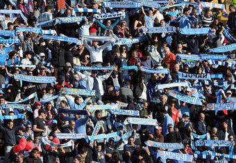 NAPLES, ITALY - FEBRUARY 06:  Napoli  fans show their support during the Serie A match between SSC Napoli and AC Cesena at Stadio San Paolo on February 6, 2011 in Naples, Italy.  (Photo by Giuseppe Bellini/Getty Images)