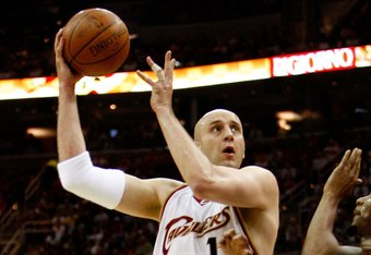 CLEVELAND - MAY 22:  Zydrunas Ilgauskas #11 of the Cleveland Cavaliers drives to the hoop against the Orlando Magic in Game Two of the Eastern Conference Finals during the 2009 Playoffs at Quicken Loans Arena on May 22, 2009 in Cleveland, Ohio. NOTE TO US