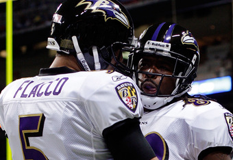 ST LOUIS, MO - SEPTEMBER 25:  Receiver Torrey Smith #82 of the Baltimore Ravens celebrates with quarterback Joe Flacco #5 after catching a pass for a touchdown during the 1st quarter of the game against the St. Louis Rams on September 25, 2011 at the Edwa