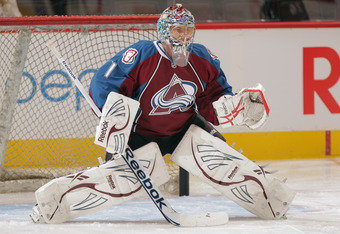 DENVER, CO - SEPTEMBER 23:  Goalie Semyon Varlamov #1 of the Colorado Avalanche stretches prior to facing the St. Louis Blues during their preseason game at Pepsi Center on September 23, 2011 in Denver, Colorado.  (Photo by Doug Pensinger/Getty Images)