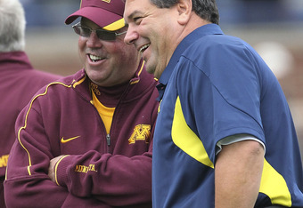 Michigan coach Brady Hoke with Minnesota coach Jerry Kill