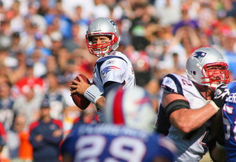 ORCHARD PARK, NY - SEPTEMBER 25: Tom Brady #12 of the New England Patriots looks to pass against the Buffalo Bills  at Ralph Wilson Stadium on September 25, 2011 in Orchard Park, New York.  Buffalo won 34-31 (Photo by Rick Stewart/Getty Images)