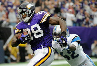 MINNEAPOLIS, MN - SEPTEMBER 25: Adrian Peterson #28 of the Minnesota Vikings avoids a tackle by Amari Spievey #42 of the Detroit Lions on September 25, 2011 at Hubert H. Humphrey Metrodome in Minneapolis, Minnesota. (Photo by Hannah Foslien/Getty Images)