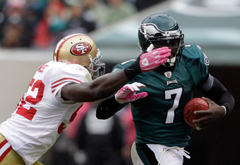 PHILADELPHIA, PA - OCTOBER 02:  Defender Patrick Willis #52 of the San Francisco 49ers tackles  quarterback  Michael Vick #7 of the Philadelphia Eagles during the first half at Lincoln Financial Field on October 2, 2011 in Philadelphia, Pennsylvania.  (Ph
