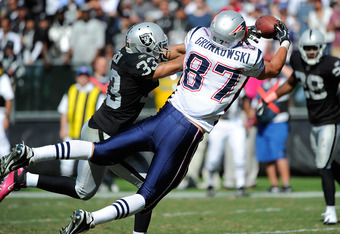 OAKLAND, CA - OCTOBER 02: Rob Gronkowski #87 of the New England Patriots can't hold on to this pass over Tyvon Branch #33 of the Oakland Raiders in the second quarter during an NFL football game at O.co Coliseum on October 2, 2011 in Oakland, California.