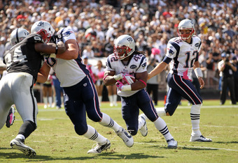 OAKLAND, CA - OCTOBER 02:   Tom Brady #12 hands off to  BenJarvus Green-Ellis #42 of the New England Patriots who ran in for a touchdown against the Oakland Raiders at O.co Coliseum on October 2, 2011 in Oakland, California.  (Photo by Ezra Shaw/Getty Ima