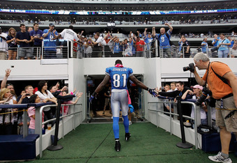 ARLINGTON, TX - OCTOBER 02:   Calvin Johnson #81 of the Detroit Lions heads to the locker room after catching the game-winning touchdown to beat the Dallas Cowboys 34-30 at Cowboys Stadium on October 2, 2011 in Arlington, Texas.  (Photo by Tom Pennington/