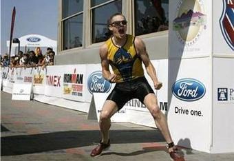 Symonds celebrates after crossing the finish line at Lake Las Vegas.