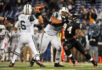 BALTIMORE - OCTOBER 2:  Sergio Kindle #94 of the Baltimore Ravens rushes Mark Sanchez #6 of the New York Jets at M&T Bank Stadium on October 2. 2011 in Baltimore, Maryland. The Ravens defeated the Jets 34-17. (Photo by Larry French/Getty Images)