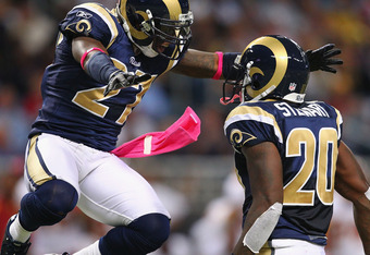 ST. LOUIS, MO - OCTOBER 2:  Quintin Mikell #27 and Darian Stewart #20 both of the St. Louis Rams celebrate breaking up a pass against the Washington Redskins at the Edward Jones Dome on October 2, 2011 in St. Louis, Missouri.  The Redskins beat the Rams 1