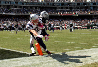 OAKLAND, CA - OCTOBER 02:   Wes Welker #83 of the New England Patriots catches the ball on the one yard line in front of  Chimdi Chekwa #35 of the Oakland Raiders at O.co Coliseum on October 2, 2011 in Oakland, California.  (Photo by Ezra Shaw/Getty Image