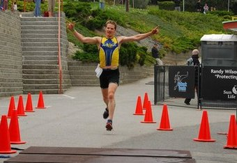 A characteristically exuberant Symonds crosses the finish line in an earlier race.