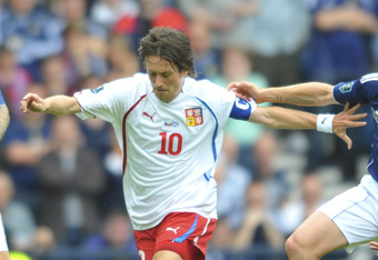 Tomas Rosicky charges through the Scottish Midfield in their last European Qualifier.