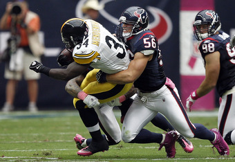 HOUSTON - OCTOBER 02:  Running back  Rashard Mendenhall #34 of the Pittsburgh Steelers is tackled by linebacker Brian Cushing #56 of the Houston Texans at Reliant Stadium on October 2, 2011 in Houston, Texas.  (Photo by Bob Levey/Getty Images)