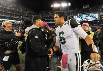 BALTIMORE - OCTOBER 2:  Head coach John Harbaugh of the Baltimore Ravens shakes hands with Mark Sanchez #6 of the New York Jets at M&T Bank Stadium on October 2. 2011 in Baltimore, Maryland. The Ravens defeated the Jets 34-17. (Photo by Larry French/Getty