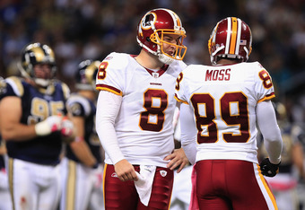 ST. LOUIS, MO - OCTOBER 2:  Rex Grossman #8 and Santana Moss #89 of the Washington Redskins speak during the game against the St. Louis Rams October 2, 2011 at the Edward Jones Dome in St. Louis, Missouri. The Redskins defeated the Rams 17-10. (Photo by W