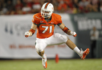 MIAMI, FL - SEPTEMBER 17: Anthony Chickillo #71 of the Miami Hurricanes celebrates after recording his first quarterback sack against the Ohio State Buckeyes on September 17, 2011 at Sun Life Stadium in Miami, Florida. The Hurricanes defeated the Buckeyes