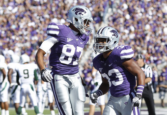 MANHATTAN, KS - OCTOBER 1: John Hubert #33 of the Kansas State Wildcats celebrates with Sheldon Smith #87 after scoring a touchdown in the first half against the Baylor Bears at Bill Snyder Family Football Stadium on October 1, 2011 in Manhattan, Kansas.