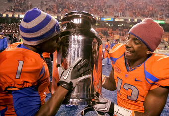 BOISE, ID - NOVEMBER 19:  Titus Young #1 kisses and Brandyn Thompson #13 of the Boise State Broncos carries the Milk Can, which is the Boise State - Fresno State rivalry trophy, at Bronco Stadium on November 19, 2010 in Boise, Idaho.  (Photo by Otto Kitsi
