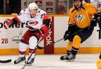NASHVILLE, TN - OCTOBER 01:  Zac Dalpe #22 of the Carolina Hurricanes pokes the puck away from Niclas Bergfors #18 of the Nashville Predators at the Bridgestone Arena on October 1, 2011 in Nashville, Tennessee.  (Photo by Frederick Breedon/Getty Images)