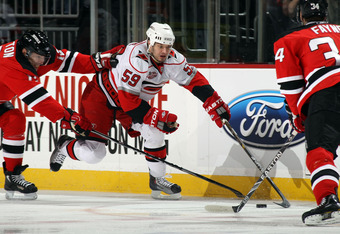 NEWARK, NJ - FEBRUARY 16:  Chad LaRose #59 of the Carolina Hurricanes skates against the New Jersey Devils at the Prudential Center on February 16, 2011 in Newark, New Jersey.  (Photo by Bruce Bennett/Getty Images)