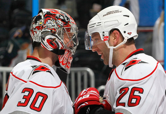 ATLANTA, GA - FEBRUARY 13:  Erik Cole #26 and goaltender Cam Ward #30 of the Carolina Hurricanes celebrate after their 3-2 win over the Atlanta Thrashers at Philips Arena on February 13, 2011 in Atlanta, Georgia.  Cole scored the game-winning goal in the