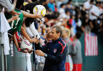 CARSON, CA - AUGUST 31:  Jurgen Klinsmann coach of US Men's National Team signs soccer balls and soccer jersey after training at The Home Depot Center on August 31, 2011 in Carson, California. United States will play Costa Rica in friendly soccer match on