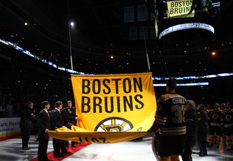 BOSTON, MA - OCTOBER 06:  The Boston Bruins raise their Stanley Cup Chapionship Banner before their season opening game against the Philadelphia Flyers on October 6, 2011 at TD Garden in Boston, Massachusetts.  (Photo by Elsa/Getty Images)
