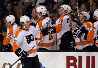 BOSTON, MA - OCTOBER 06:  Claude Giroux #28 of the Philadelphia Flyers is congratulated by teammates after he scored in the first period against the Boston Bruins on October 6, 2011 at TD Garden in Boston, Massachusetts.  (Photo by Elsa/Getty Images)