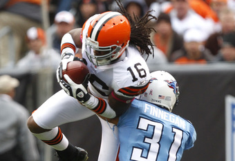 CLEVELAND, OH - OCTOBER 02:  Cornerback Cortland Finnegan #31 of the Tennessee Titans tackles wide receiver Joshua Cribbs #16 of the Cleveland Browns at Cleveland Browns Stadium on October 2, 2011 in Cleveland, Ohio.  (Photo by Matt Sullivan/Getty Images)