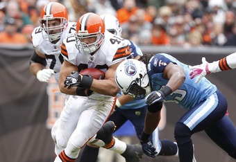 CLEVELAND, OH - OCTOBER 02:  Running back Peyton Hillis #40 of the Cleveland Browns is tackled by safety Michael Griffin #33 of the Tennessee Titans at Cleveland Browns Stadium on October 2, 2011 in Cleveland, Ohio.  (Photo by Matt Sullivan/Getty Images)