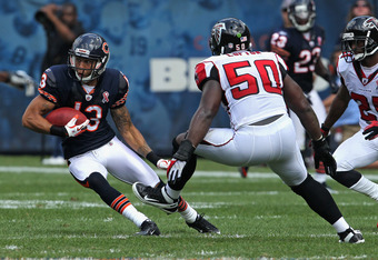 CHICAGO, IL - SEPTEMBER 11:  Johnny Knox #13 of the Chicago Bears moves against Curtis Lofton #50 of the Atlanta Flacons after catching a pass at Soldier Field on September 11, 2011 in Chicago, Illinois. The Bears defeated the Falcons 30-12.  (Photo by Jo