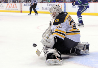 VANCOUVER, BC - JUNE 15:  Tim Thomas #30 of the Boston Bruins makes a save against the Vancouver Canucks during Game Seven of the 2011 NHL Stanley Cup Final at Rogers Arena on June 15, 2011 in Vancouver, British Columbia, Canada.  (Photo by Harry How/Gett