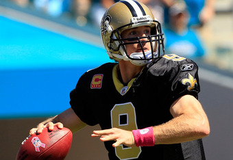 JACKSONVILLE, FL - OCTOBER 02:  Drew Brees #9 of the New Orleans Saints attempts a pass during a game against the Jacksonville Jaguars  at EverBank Field on October 2, 2011 in Jacksonville, Florida.  (Photo by Sam Greenwood/Getty Images)