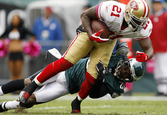 PHILADELPHIA, PA - OCTOBER 2: Running back Frank Gore #2 of the San Francisco 49ers drags cornerback Asante Samuel #22 of the Philadelphia Eagles into the end zone for a touchdown during an NFL football game at Lincoln Financial Field on October 2, 2011 i
