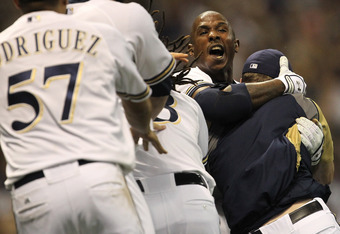 MILWAUKEE, WI - OCTOBER 07:  Nyjer Morgan #2 of the Milwaukee Brewers celebrates with teammates after getting the game-winning RBI scoring teammate Carlos Gomez #27 to defeat the Arizona Diamondbacks 3-2 in 10 innings in Game Five of the National League D