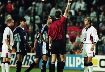 30 Jun 1998:  David Beckham of England is sent off by referee Kim Nielsen after lashing out at Diego Simeone of Argentina during the World Cup second round match at the Stade Geoffroy Guichard in St Etienne, France. England lost 4-3 on penalties as the en