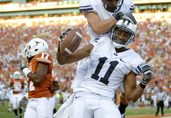 AUSTIN, TX - SEPTEMBER 10:  Wide receiver Ross Apo #11 of the BYU Cougars celebrates a second quarter touchdown pass against the Texas Longhorns with teammate J. D. Falslev #12 on September 10, 2011 at Darrell K. Royal-Texas Memorial Stadium in Austin, Te