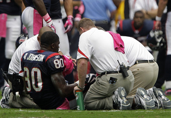 HOUSTON, TX - OCTOBER 02: Wide receiver Andre Johnson #80 of the Houston Texans is seen by team doctors after he pulled his hamstring against the Pittsburgh Steelers on October 2, 2011 at Reliant Stadium in Houston, Texas.Johnson left the game becasue of