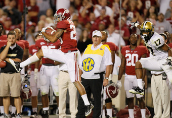 Alabama's No. 28 Dee Milliner high steps it for a 34-0 win against Vandy